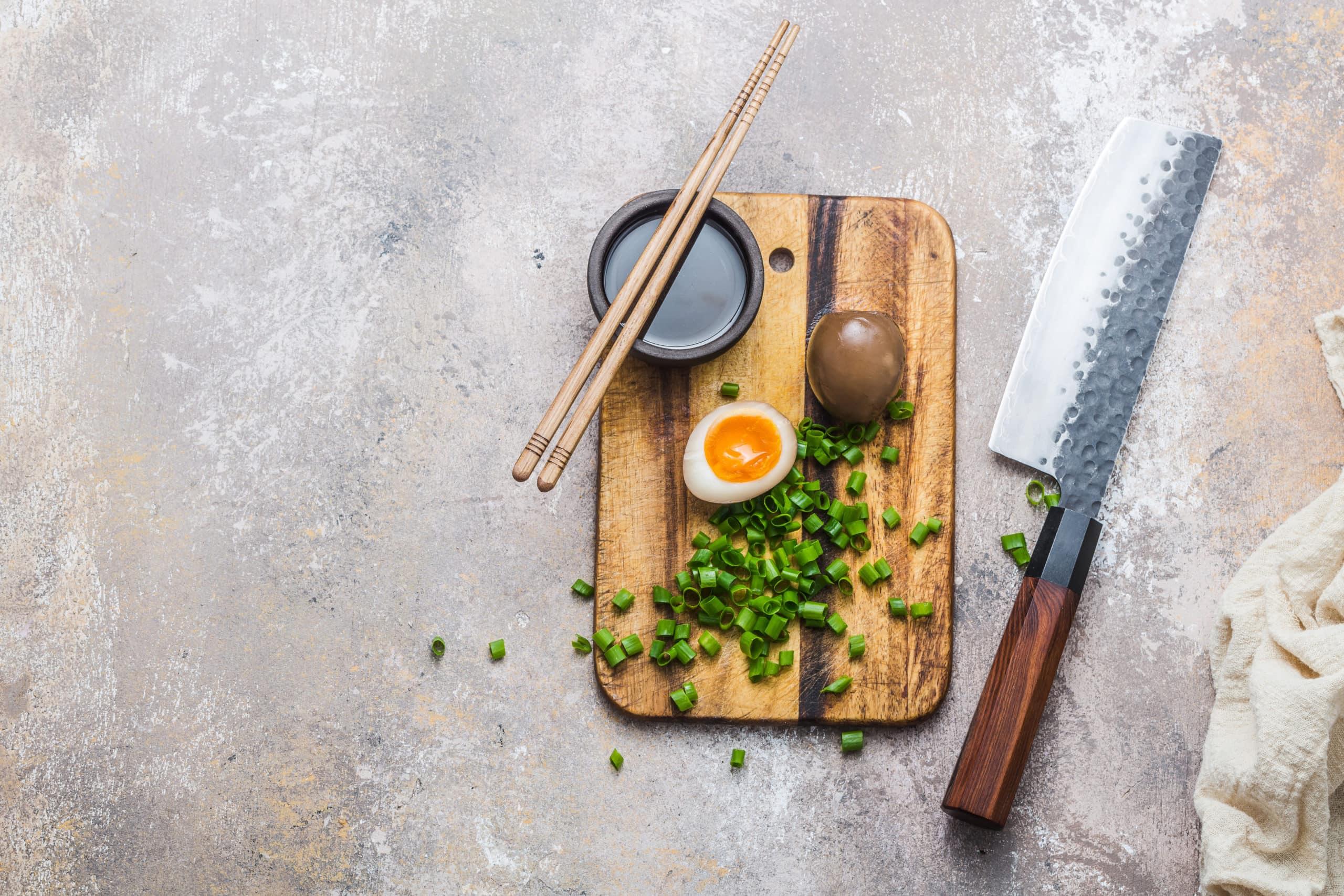 Marinated egg nitamago on cutting board, copy space.