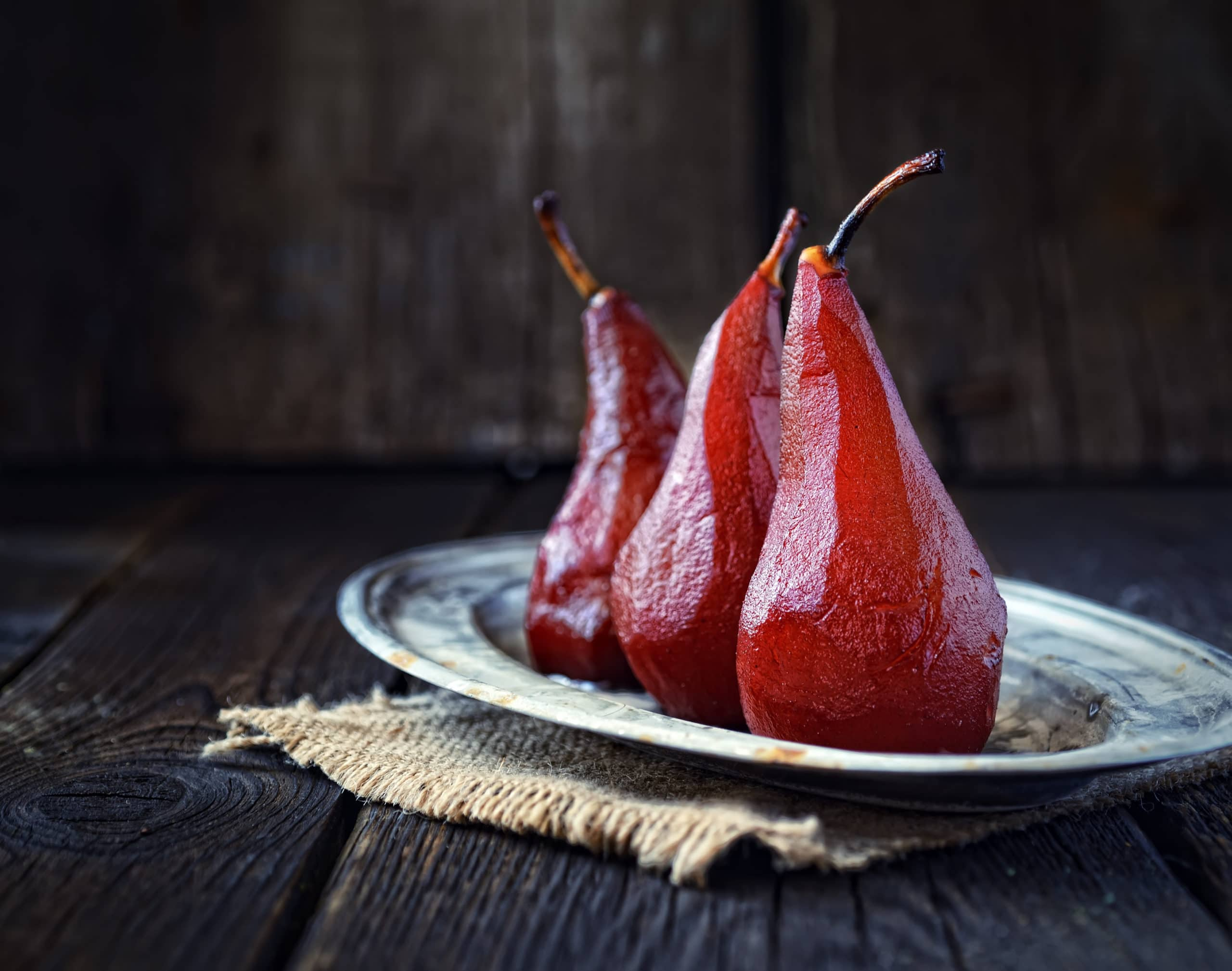 Pears In Red Wine On A Vintage Plate And Wood Background